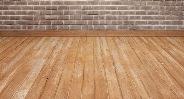 wooden-floor-with-brick-wall_1249-179